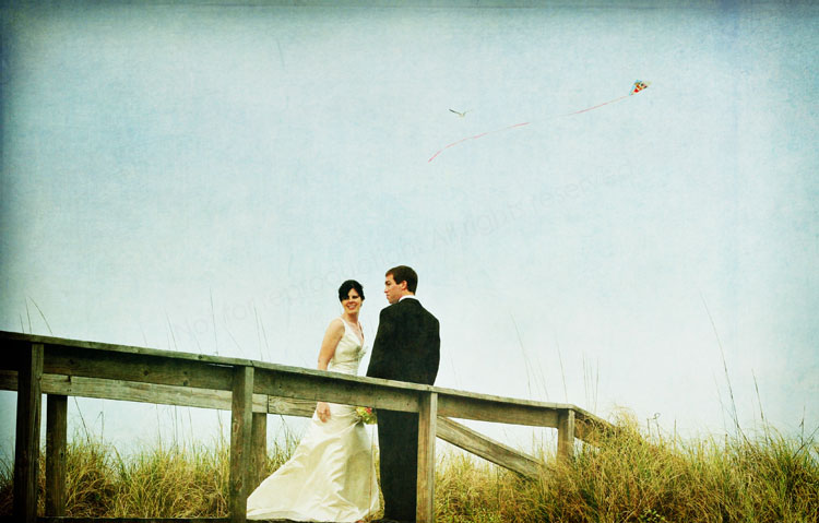 Mary Ann and Mike McDufford on their way to the beach after their ceremony. This image was from an oldere wedding but I wanted to try to add some texture and tinting to the image and always loved the shot.
