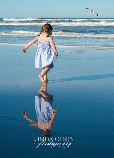 toddler running at beach