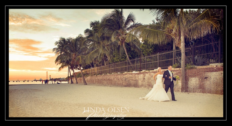 Destination weddings are pretty much the same as local weddings except for not being familiar with a venue and not knowing how the light will play out. Vaughn Goebel and Cathy Andorfer tied the knot at the Key West Garden Club last Saturday and it turned out to be a beautiful event with perfect weather and a sunset 15 minutes after the ceremony. I had to do a lot of fast portraits so we didn't miss the last shots on the beach outside of the old civil war fort (now the Key West Garden Club) which is on the Atlantic side of Key West. I was afraid that we would not get a sunset because of weather and angle of the location to the south not west. I had to photoshop a lot of people out who were also watching a beautiful sunset. I do like destination weddings because we also get to be involved in other activities during the week and get to know the families and guests better. And the real bonus is to have some down time relaxing and exploring a cool place. Nelson and I hadnt been to Key West since our honeymoon 11 years ago and not much had changed but we got to be tourists for a bit and enjoy this unique island community with all kinds of historical hot spots. Congratulations to Cathy & Vaughn!!