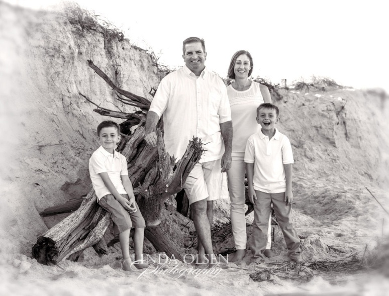 The Neel family from Neptune Beach wanted a beach portrait since they live  at the beach but after hurricane Matthew blew through, we are missing a substantial part of the beach. The dunes which normal are a gradual slope to the sandy beach became a cliff of sand where 8-10 feet inland and at least 5-6 feet vertically is missing. We made it work but missed the lovely sea oats which were destroyed.